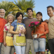 Happy Family Standing Together In Garden — Stock Photo