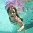 Stock Photo: Girl Swimming Underwater