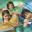 Siblings Enjoying Together In Swimming Pool — Stock Photo
