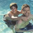 Father And Son Enjoying In Pool - Foto de Stock