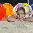 Girl In Swimming Pool With Beach Balls — Stock Photo