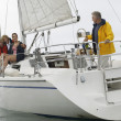 Family Sailing On Boat During Vacations - Stock Photo
