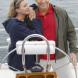 Stock Photo: Couple Standing By Helm On Sailboat