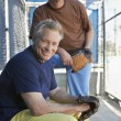 Men With Mitts In Baseball Dugout — Stock Photo #21949029