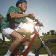Man Riding Bicycle In Park — Stock Photo