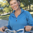 Stock Photo: Happy WomWith Bicycle