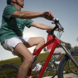Two Multiethnic Friends Riding Bicycles — Stock Photo #21949183