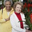 Senior Female Friends At Botanical Garden — Stock Photo #21949275