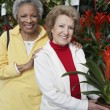 Senior Female Friends At Botanical Garden — Stock Photo