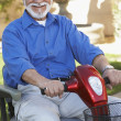 Stock Photo: Senior MOn Motor Scooter