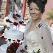 Happy Beautiful Quinceanera Holding Flowers — Stock Photo
