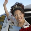 Quinceanera Waving Hand From Car Window - Stock Photo