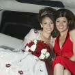 Quinceanera Sitting With Mother In Limousine - Stock Photo