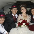 Quinceanera Sitting With Three Male Friends In Limousine - Stock Photo