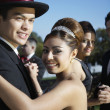 Happy couple dancing at Quinceanera - Stock Photo