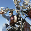 Stock Photo: Biker Riding Motorcycle Against Clear Sky