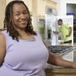 Happy Obese Woman At Kitchen Counter — Stock Photo