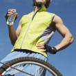 Male Cyclist Holding Bottle Of Water — Stock Photo #21949907