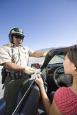 Cop Checking Woman's License — Stock Photo