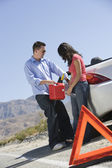 Couple With Oil Can Standing By Car — Stock Photo