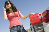 Woman Refueling Her Car While Talking On Cell Phone — Stock Photo