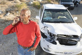 Senior Man On Call With Damaged Car In The Background — Stock Photo