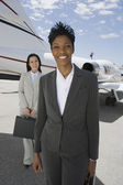 Confident Businesswomen Standing At Airfield — Stock Photo
