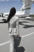 Businesswoman Walking Towards Private Airplane — Stock Photo