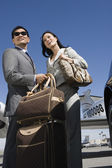 Business Couple Standing At Airfield — Stock Photo