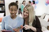 Women Reading Greeting Card At A Baby Shower — Stockfoto