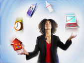 Businesswoman Juggling Responsibilities — Stockfoto