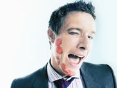 Flirtatious Businessman With Lipstick Kiss Marks — Stock Photo
