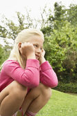 Girl Crouching In Park — Stock Photo