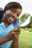Girl Using Magnifying Glass — Stock Photo