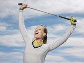 Female Golfer Holding Club Against Sky — Stock Photo
