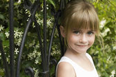Girl Leaning On Fence — Stock Photo