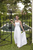 Bride Standing At The Entrance Gate — Stock Photo