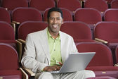 Happy Businessman Using Laptop In Auditorium — Foto de Stock