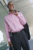 Businessman Holding Coat Over Shoulder — Stock Photo
