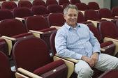 Man Sitting In Auditorium Chair — Stock Photo