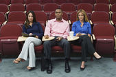 Business Sitting In Auditorium — Stock Photo