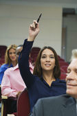 Executive Raises Hand During A Seminar — Stock Photo