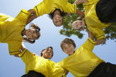 Soccer Team Forming Huddle — Foto de Stock