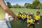 Coach In Front Of Girl Soccer Players — Stock Photo