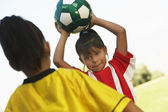 Girl About To Throw The Soccer Ball — Stock Photo