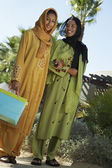 Muslim Friends In Traditional Wear Standing Together — Stock Photo