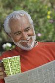 Happy Senior Man Reading Newspaper — Stock Photo