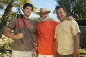 Happy Men Standing In Garden — Stock Photo