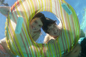 Happy Brother And Sister Looking Through Inflatable Ring — Foto Stock