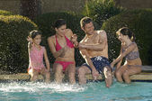 Family Having Fun At Swimming Pool — Stock Photo